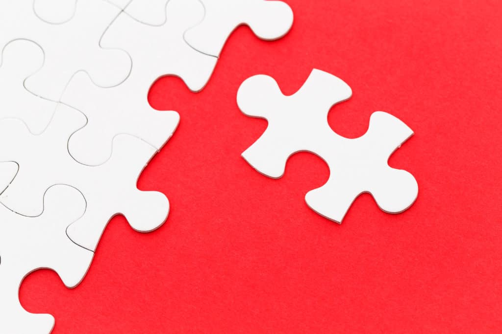 Red and White Jigsaw Puzzle Connecting