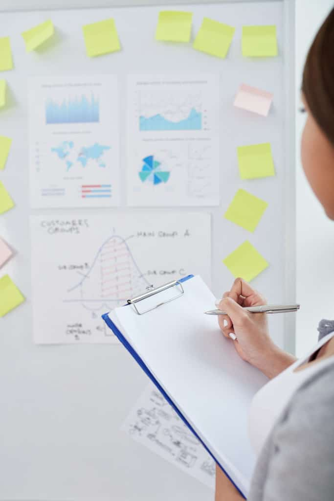 Girl Analyzing Data on a Whiteboard
