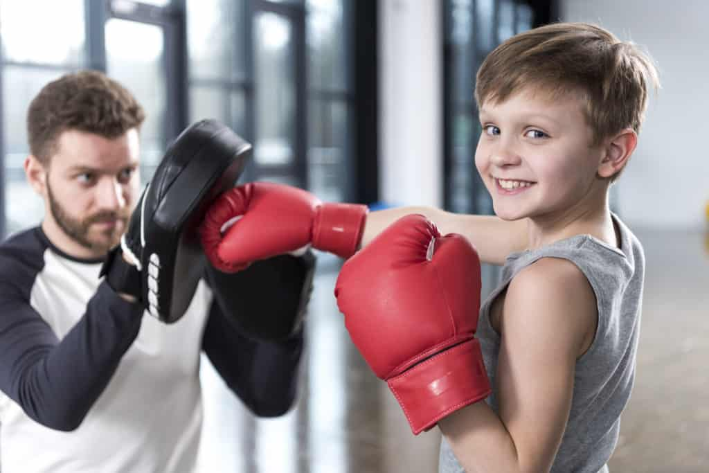 Kid Practicing Boxing to Improve Skills