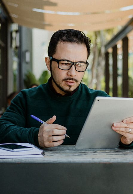 man working using digital tablet